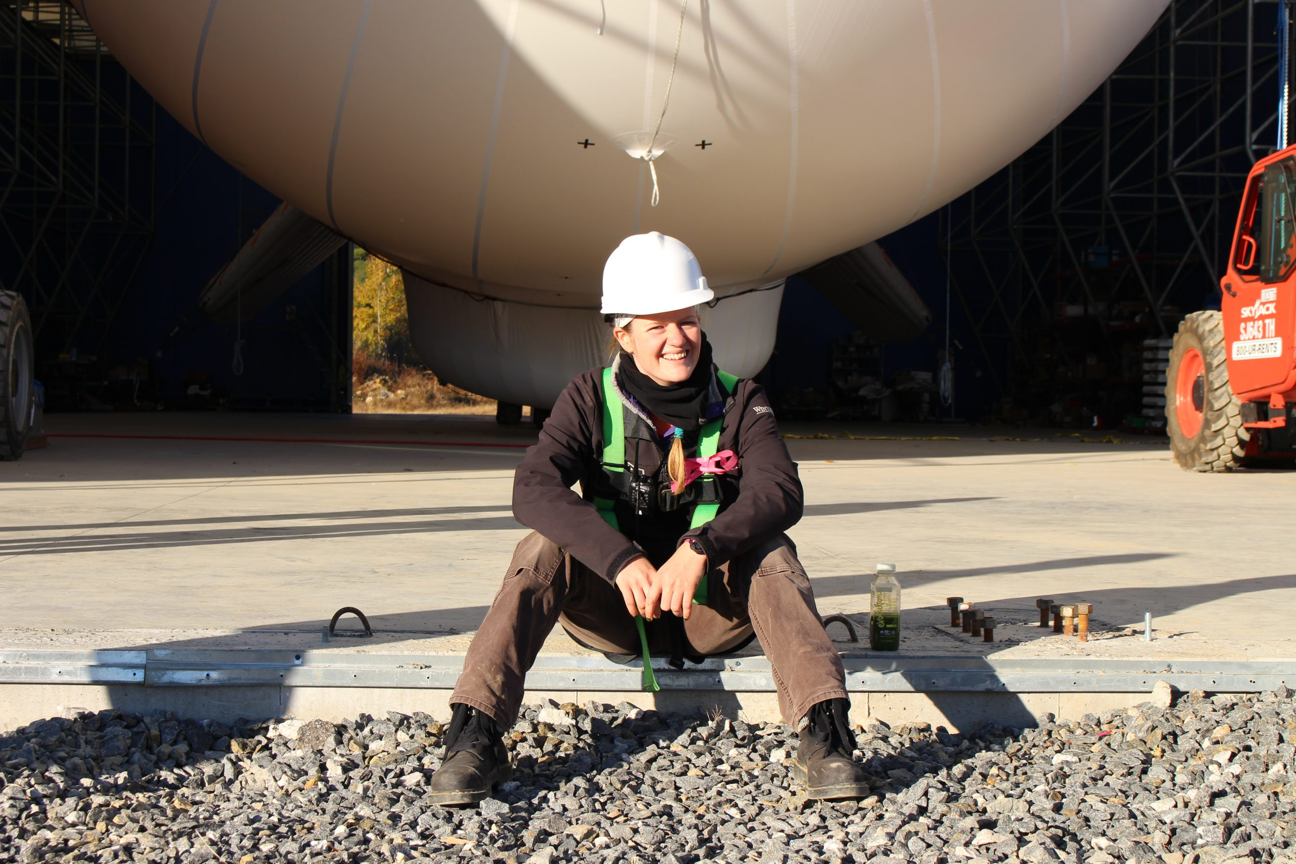 An engineer with a hard hat sits near a SuperTower