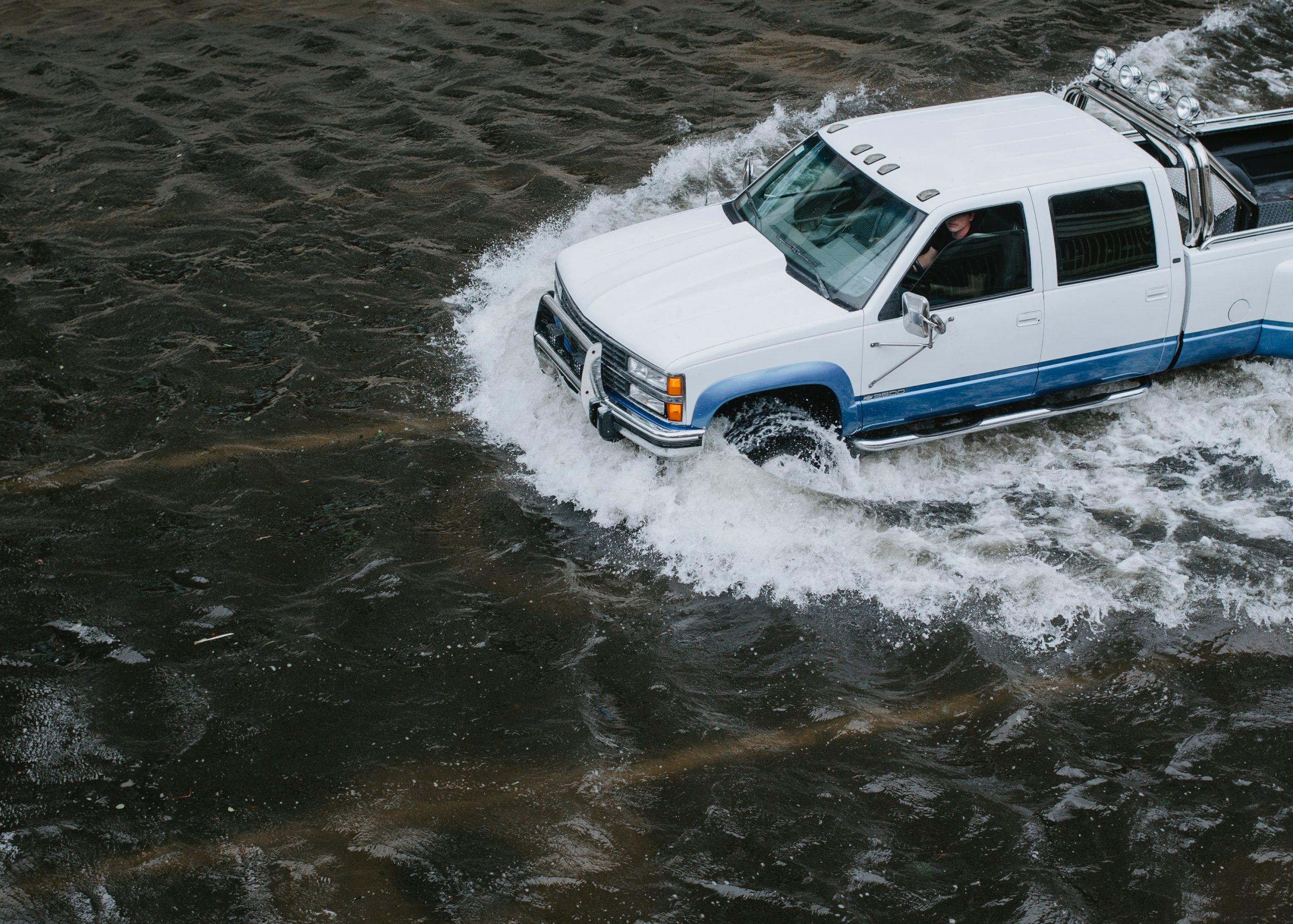 Emergency Response Truck Drives through deep water